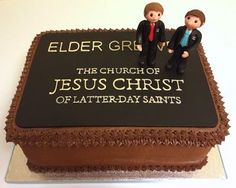 Double Chocolate Cake. Chocolate missionary badge with piped chocolate lettering and chocolate missionary figurines. Elaine's Sweet Life: Missionary Send-off Cake