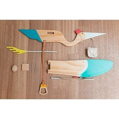 Add a playful touch to your child's room with the Wooden Stork Mobile from Eguchi Toys. Just pull on the leather strap and watch as the wings flap up and down. This friendly pine accent features a basket with a wooden egg tucked inside. Buy Buy Baby, Forest Animals, Stork, 3 Things, Your Child, Clothes Hanger, Wooden Toys, Kids Room, Basket
