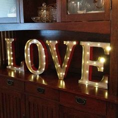 This set of vintage illuminated marquee letters spells the word LOVE. Illuminated by warm white LEDs, this battery-operated sign runs on eight AA batteries (. Marquee Sign, Marquee Lights, Light Up Letters, Metal Letters, Battery Operated Led Lights, Led Lighting Home, Lighting Suppliers, Love Holidays, Love Signs