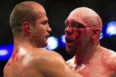 Junior Dos Santos - current UFC Heavyweight Champ, bracing former interim heavyweight champ Shane Carwin after a bloody exchange. Dos Santos is one of the nicest guys in the world, but if crossed, he'll do this to your face!
