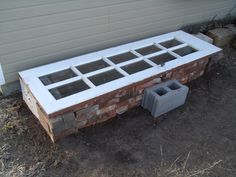 cold frame from spare blocks and bricks and glass door