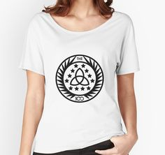 The 100 - Insignia T-Shirt by #BadCatDesigns. Inspired by #The100 series, it depicts the logo seen on the TV show on pins worn by the Council and on the patches worn by the Guards.