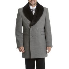 Nothing says sophistication like a wool top coat. This double-breasted coat features a faux fur collar and distinguished design.