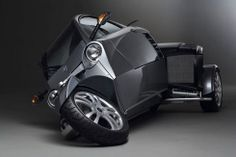 At the other extreme of these high performance cars is the Carver One, a three-wheeled, twin-seat tilting vehicle. The Carver One steers like a car but turns like a motorcycle. The car automatically adjusts the tilt angle of the vehicle to the speed and acceleration of the vehicle, ensuring an optimum balance.