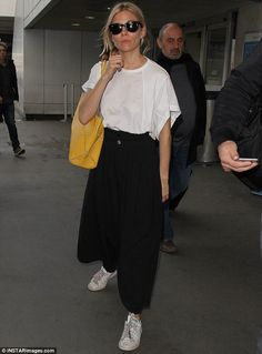 Baggy chic: Trendy Sienna Miller wore trendy culottes after touching down in LA on Thursday