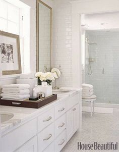 long white vanity  subway tile  marble mosaic floor  david jimenez