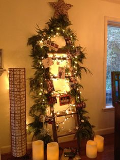 i dont have much space for my christmas tree so i took an old ladder draped it with real garland and white lights christmas card photos from my friends - Christmas Ladder Decor