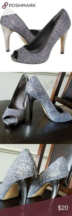 "Nine West Silver Confetti Mirrored Escher Heels Classic shape. Silver glitter/confetti detailing. Peep toe. 4"" mirror reflective Escher heel. 1/2"" platform. Great party shoes!  Vegan man-made materials. Minor scratches on heels. Normal wear on soles. Sz 6M. By Nine West. Nine West Shoes Heels"