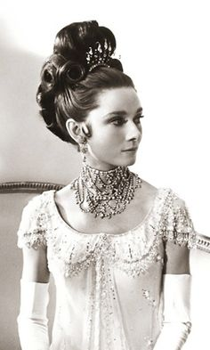 "Audrey Hepburn in a classical Grecian empire dress in the 1964 classic ""My Fair Lady."""