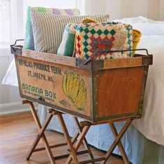 DIY Furniture Makeovers - Vintage Catchall - Use an old fruit crate and camping stools to make a creative holder for items such as quilts and pillows.