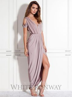 Exclusive Dionne Dress. A grecian inspired maxi dress with wrap skirt by designer Pia Gladys Perey. Features beautifully draped scooped wrap-style skirt and draped shoulder detail.