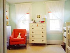Love the window treatments, and surprised by how wel the faint mint and hot orange work together