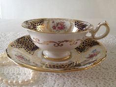 Beautiful vintage china tea cup, made by Royal Chelsea in England. This is a Stunning cabinet duo on a cobalt ground with tons of hand painted gold gilding on both the cup and saucer. It is in good condition, no chips, cracks or crazing. Please Note: The items I sell are not