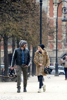 Bradley Cooper and Suki Waterhouse shared a smile in Paris.