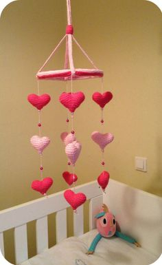 Baby crib mobile with pink and fuchsia crocheted by evrettou, $33.85