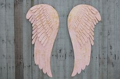 Stunning set of large, hand painted metal angel wings. Done in very soft pink and accented in gold with a protective coating. They each have 2 hangers on the back and can be hung in several different