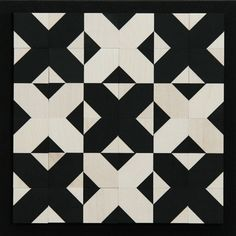 Versi by naef  -    Fascination of diagonals.   A cube, two geometrical patterns, six sides, endless possibilities.   The diagonals are a fascinating aspect of this black and white mosaic, inspiring one to keep trying out new combinations and playfully acquaint oneself with this multi-faceted and unconventionally diagonal world.  designer: Ben Nicholson