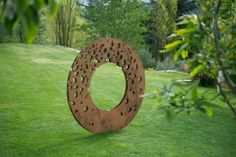 Leaf Fall - Corten steel -  1500 x 1500 x 150mm, 2011 A commissioned sculpture for a collector with a leafy landscaped garden. Mounted on a revolving spindle the sculpture turns in the wind like the leaves during their cycle of life. by Martin Hill