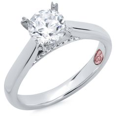 Designer Engagement Rings from DemarcoJewelry.com  Available in White Gold 18KT and Platinum.0.07 RD Capture her grace and endless beauty with this confident yet elegant design. We have also incorporated a unique pink diamond with every single one of our rings, symbolizing that hidden, unspoken emotion and feeling one carries in their heart about their significant other.   This is not just another ring, this is a heirloom piece of jewelry.
