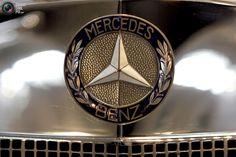 The logo of a Mercedes Benz SSK 'Comte Trossi' 1930 vintage sport car