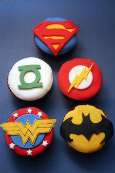 Superhero Cupcakes- just got ready-to-roll fondant and gel colors to try my hand at these!
