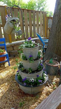 What a cute idea... Layering these buckets with a watering can hanging from this shepherds hook for pots!!! Have to try it!!!
