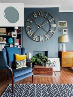 No-Fail Colors for Living Spaces. Twilight Blue wall with large clock face illustrating no-fail paint shades for living spaces. Living Room Paint and Decor Blue Living Room, Living Room Paint, Living Room Colors, Paint Colors For Living Room, Living Room Diy, Living Room Interior, Living Room Wall, Brown Living Room, Living Decor