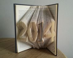 """2014 New year -- Folded book art"""