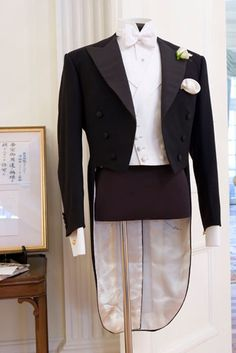 The London Cut: Japan Exhibition // Henry Poole & Co Evening Tails inspired by those tailored for Crown Prince Hirohito in 1921 flanked by Poole's Royal Warrant for the Japanese Imperial Household.