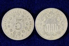 The Shield Nickel was first minted in 1866 and was designed by James E. Longacre. The original design of the reverse displayed a ring of rays and stars around the number five. This design element was change part way through 1867 when the rays were removed. The series ran until 1883 when it was replaced by the Liberty Nickel. The Shield Nickel is also the first official Nickel of the United States!