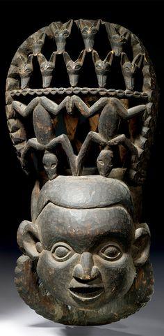 Africa | Janus head helmet mask from the western Grassfields of Cameroon | Wood