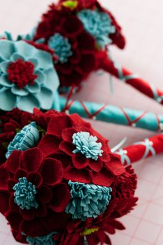 Cool. Felt flower bouquet. I'm a sucker for red and turquoise!