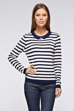 - Details - Shipping - Returns You're the one that puts homework first, corrects your friend's grammar, and always has a book nearby. With this blue and white collared sweater you can definitely look