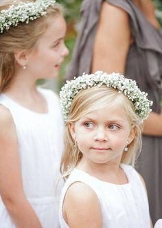 Flower girls with wreathes of baby's breath in their hair