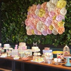 A huge and blossomed #dessert #table with a backdrop only #rpsevents team could pull off!