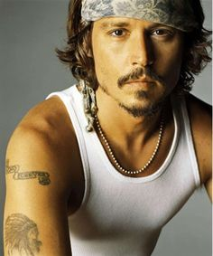 Johnny Depp... When he isn't speaking or being sucha FREAKIN WEIRDO, he is kinda cute. Shut it, Johnny, and just play pretty.