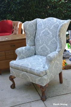 Reupholstering a wingback chair is time-consuming and expensive, but it's a lot of fun! Here's how to reupholster a wingback chair, from start to finish! #WingbackChair