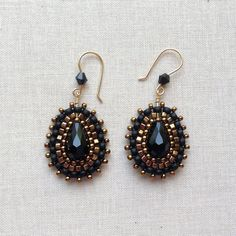 Bling earrings similar to Miguel Ases - made by Lisa Yang Jewelry.  Lots of free tutorials at her site.