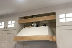 A step-by-step tutorial to build your own wooden range hood. Buy a range hood liner insert and then learn how to build the stove range hood yourself. House, Wood Range Hood, Home, Cooker Hoods, Farmhouse Style Kitchen, Stoves Range, Kitchen Redo, White Kitchen Hood, Kitchen Range Hood