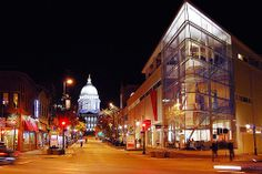 State Street Madison WI. Can't wait to eat at the restaurant on top of the glass building.