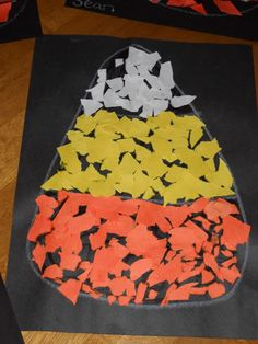 Moms Like Me: Candy Corn Craft Halloween Craft Day I used brown paper for the background to save on black and I liked the color scheme better. The kids decided to cut them out before hanging them on the wall. Daycare Crafts, Toddler Crafts, Crafts For Kids, Daycare Ideas, Toddler Art, Kids Diy, Theme Halloween, Halloween Activities, Preschool Halloween