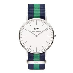 Stylish and slim watch with nato band from Daniel Wellington. The thin clock enables the clock is near and nicely on the wrist.  Natostraps wood at the clock and are interchangeable. See category NATO Ribbons for additional NATO ties. Link: NATO Band  Color: Blue, green, blue  ring color: Silver  Dial: eggshell white  Movement: Quartz Japan citizen 1L22 movement.  Size diameter: 40 mm  Height casing: 6 mm  Water resistance: 3 ATM  Warranty: 2 years