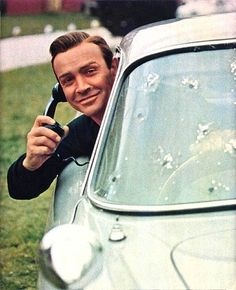 So much awesome - James Bond (the real one), a sweet car, bullet holes, and a CELL PHONE!
