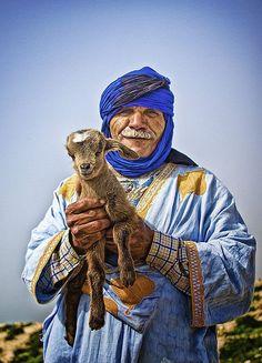 Berber in the Kasbah, Agadir, Morocco.  Photo:  FreakyLeo (Love the kid goat!!)