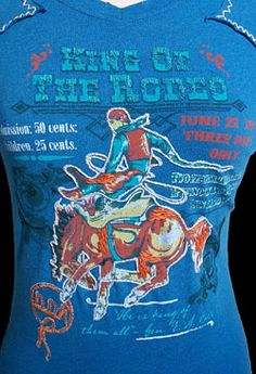 Sagebrush Sirens: Double D Ranch King of the Rodeo Tee-Embellished enough you know it is the one and only Double D and understated enough for the fashion timid!    Brushed 100% cotton is incredibly soft while the fun print is accented with embroidery and contrast stitching.     For a day at the rodeo, pair with your favorite boots and some beat up jeans for a look that is nothing short of cowgirl cool!     $132