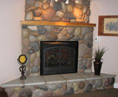 River rock fireplace...this is somewhat of a smaller version of the one in our house in Oscoda when I was a kid.