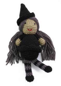 Wanda the Witch--I made her with red sequin shoes, green skin and red and white striped stockings. We're not in Kansas anymore.