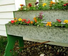 """Up-cycled turkey feeders could be a good place to plant strawberries. Legs are painted 1/2"""" plywood screwed to sides."""