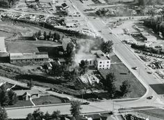 The Canadian Nazarene College, S of 45 St. Photo is looking S. Gaetz Ave is on the right. The College buildings are being demolished because the campus had been sold to Safeway. The site would be redeveloped for the Port O Call store. 1961 Red Deer, AB