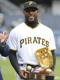 Pittsburgh Pirates center fielder Starling Marte stands with his Golden Glove Award before the start of the Pittsburgh Pirates home opener…